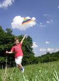 Enfant avec le cerf-volant Photos stock