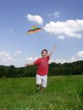 Enfant avec le cerf-volant Images stock