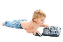 Enfant avec le clavier et la souris photos stock