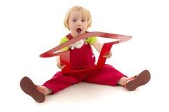 Enfant avec le dard rouge Image libre de droits