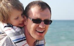 Enfant avec le père Photographie stock