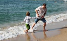 Enfant avec le père Photos libres de droits
