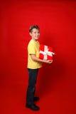 Enfant avec le présent Photographie stock libre de droits