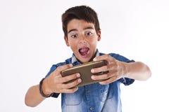 Enfant avec le téléphone portable Photo stock