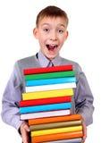 Enfant avec les livres photo libre de droits