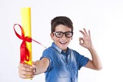 Enfant avec un diplôme Photo stock