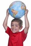 Enfant avec un globe Image libre de droits