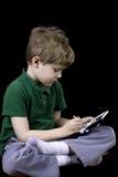 Enfant avec un jeu Images stock