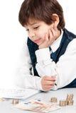 Enfant comptant l'argent Images libres de droits