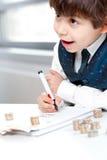 Enfant comptant l'argent Photos stock