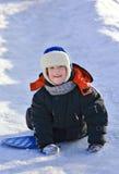 Enfant conduisant une côte figée photo libre de droits
