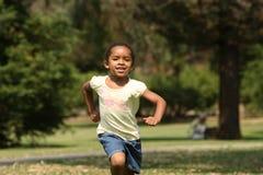Enfant courant Images libres de droits