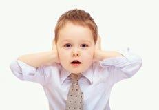 Enfant d'affaires dans l'effort en raison des problèmes Photos stock