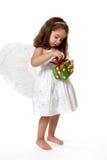 Enfant d'ange avec le cadeau de Noël Image stock