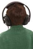 Enfant d'arrière avec des écouteurs Image libre de droits