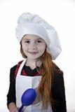 Enfant d'une chevelure rouge dans le chapeau de chef Photo stock