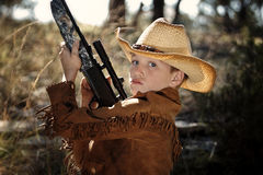 Enfant dans l'équipement de cowboy Photographie stock