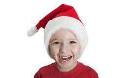 Enfant dans le chapeau de Santa Image stock