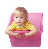 Enfant dans un cadre rose Photos stock