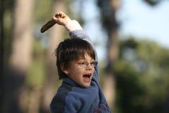 Enfant dans une cour de jeu Images stock