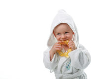 Enfant dans une robe de chambre Photographie stock libre de droits