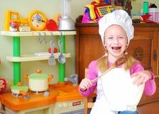 enfant de boulanger heureux Photo libre de droits
