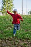Enfant de couleur qui fonctionne Photo libre de droits