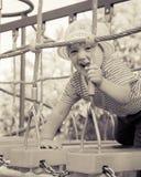 Enfant de deux ans à la cour de jeu Images stock