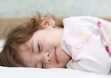 Enfant de sommeil Images stock