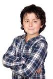 Enfant de sourire avec le T-shirt de plaid Photographie stock libre de droits