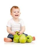 Enfant de sourire avec les pommes vertes Photos libres de droits