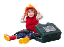 Enfant de sourire dans le masque de constructeur avec des outils Photos stock
