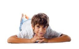 Enfant de sourire sur le plancher Image stock
