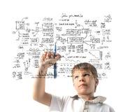 Enfant dessinant un système Photographie stock