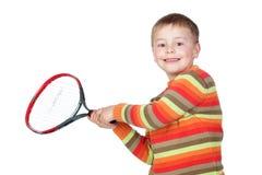Enfant drôle avec une raquette de tennis Photo libre de droits
