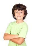 Enfant drôle avec le T-shirt vert Photographie stock libre de droits