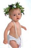 Enfant en bas âge avec des perles Photos stock