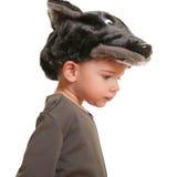 Enfant en bas âge dans un procès de carnaval de loup Photographie stock libre de droits