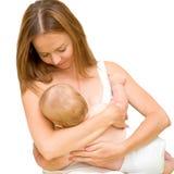 Enfant en bas âge de allaitement de mère Images libres de droits