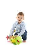 Enfant en bas âge doux avec le jouet mou Photos stock