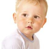 Enfant en bas âge regardant avec surprise Image stock