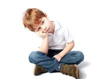 Enfant en bas âge semblant triste Photographie stock libre de droits