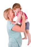 Enfant en bas âge de fixation de mère Photo stock