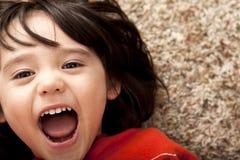 enfant en bas âge étonné par garçon Image stock