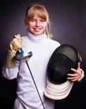 Enfant en clôturant l'epee de fixation de costume. Photo libre de droits