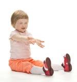 Enfant espiègle heureux prêt à attraper quelque chose images libres de droits
