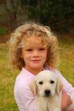 Enfant et animal familier Image libre de droits