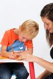Enfant et babysitter Image libre de droits