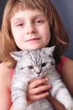 Enfant et chat Image stock