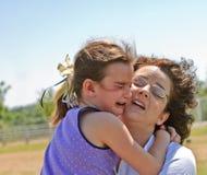 Enfant et mère pleurants Images libres de droits
